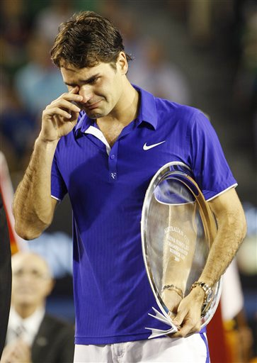 Switzerland's Roger Federer cries during the award ceremony after he lost to Spain's Rafael Nadal in the men's singles final at the Australian Open in Melbourne on Sunday. (AP Photo)