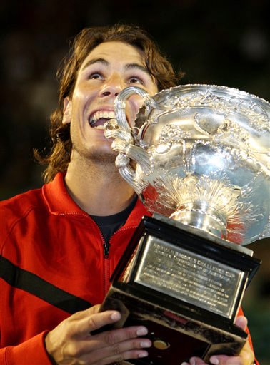 Spain's Rafael Nadal holds the trophy during the award ceremony after beating Switzerland's Roger Federer during the men's singles final match at the Australian Open in Melbourne on Sunday. (AP Photo)
