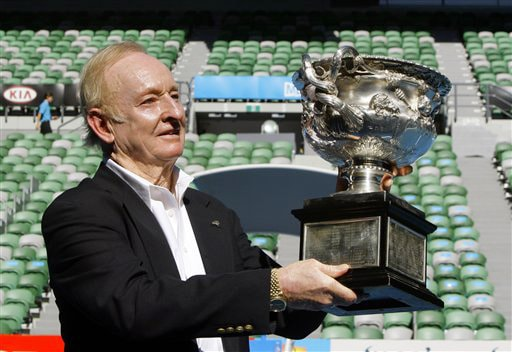 Tennis legend Rod Laver of Australia holds the men's singles trophy as he stands on Rod Laver Arena during a photocall at the Australian Open in Melbourne on Wednesday. It's the 40th anniversary of Laver's second Grand Slam of singles titles in 1969. (AP Photo)