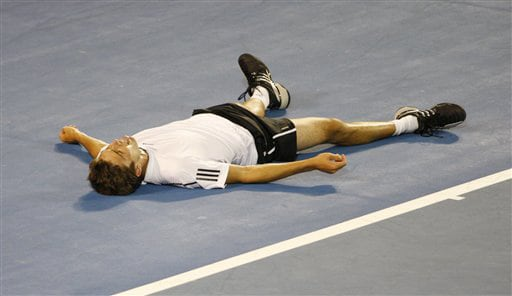 France's Gilles Simon lays on the court after he fell during his men's singles quarterfinal match against Spain's Rafael Nadal at the Australian Open in Melbourne on Wednesday. (AP Photo)