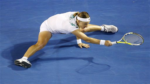 Russia's Svetlana Kuznetsova does the spilts as she makes a return to Serena Williams of the United States during a women's singles quarterfinal match at the Australian Open in Melbourne on Wednesday. (AP Photo)