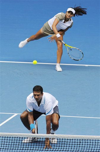 Sania Mirza and Mahesh Bhupathi play Nathalie Dechy and Andy Ram on their way to winning the mixed doubles final at the Australian Open in Melbourne.