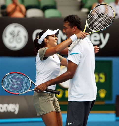 Sania Mirza and Mahesh Bhupathi celebrate after beating Nathalie Dechy and Andy Ram during the mixed doubles final at the Australian Open in Melbourne.