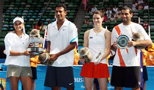 Sania Mirza and Mahesh Bhupathi hold the trophy along with runners-up Nathalie Dechy and Andy Ram during the awarding ceremony of the mixed doubles final match at the Australian Open in Melbourne.
