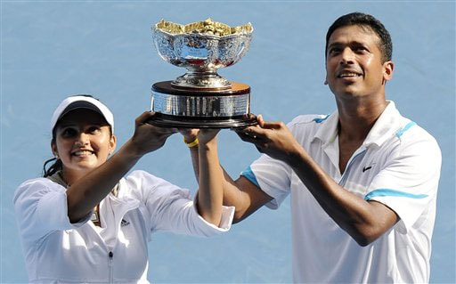 Sania Mirza and Mahesh Bhupathi hold the trophy during the awarding ceremony after beating Nathalie Dechy and Andy Ram in the mixed doubles final match at the Australian Open in Melbourne.