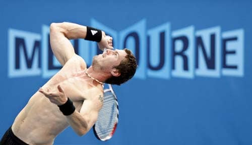 Russia's Marat Safin serving during a practice session at Melbourne Park.