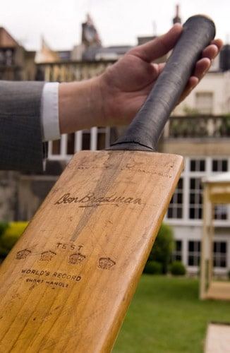 A man holds the '140 Bradman Cricket Bat' at a photocall at the Goring Hotel in central London, on July 13, 2009. The bat has been loaned to the International Cricket Hall of Fame in Bowral, New South Wales, by current owners Martin and Eugene Withers from Scotland. The '140' bat was used by Australian cricketer Sir Donald Bradman to score 140 runs against Yorkshire at Sheffield on July 16, 1934. (AFP Photo)