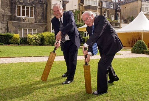Michael Ball, Chairman of the Bradman Foundation, and John Howard AC pose with two of the 'Bradman Cricket Bats' at the Goring Hotel in central London on Monday. (AFP Photo)