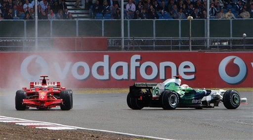 Finland's Kimi Raikkonen in his Ferrari gets past a spinning Britain's Jenson Button Honda at the Priory corner during the British Grand Prix at Silverstone, England on July 6, 2008.