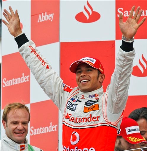 McLaren Mercedes driver Lewis Hamilton of Britain celebrates on the podium after winning the British F1 Grand Prix race in Silverstone, England on July 6, 2008.