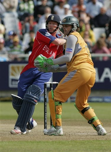 England's Paul Collingwood plays a stroke as Austalia's wicket keeper Adam Gilchrist looks during their World Twenty 20 cricket Championships match at Newlands in Cape Town, South Africa, Friday, Sept. 14, 2007.