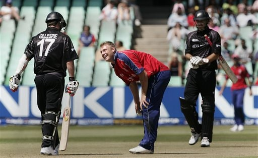 England's Andrew Flintoff, center, shares a moment with New Zealand's Mark Gillespie, left, during their Twenty20 World Championship Cricket match in Durban, South Africa, Tuesday, Sept. 18, 2007.