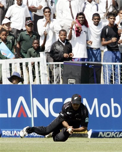 New Zealand's Jeetan Patel takes a successful catch for the dismissal of England's Dimitri Mascarenhas during their Twenty20 World Championship Cricket match in Durban, South Africa, Tuesday, Sept. 18, 2007.