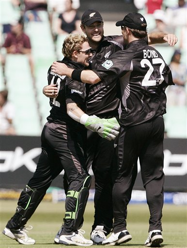 New Zealand's Daniel Vettori, center, Brendon McCullum, left and Shane Bond celebrate their teams victory over England during their Twenty20 World Championship Cricket match in Durban, South Africa, Tuesday, Sept. 18, 2007.