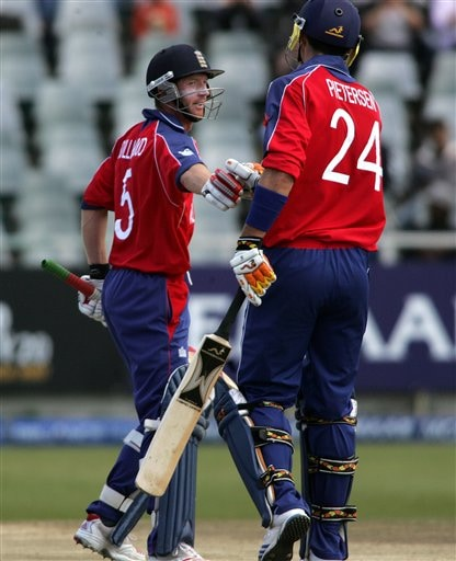England's captain Paul Collingwood, left, shakes hands with teammate Kevin Pietersen, right, after a 100 run partnership during ICC World Twenty 20 cricket Championships at Newlands in Cape Town, South Africa,Thursday, Sept. 13, 2007.