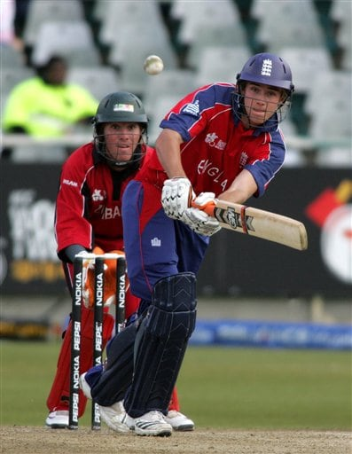 Zimbabwean wicket keeper Brendon Taylor, left, looks on as England's batsman Stuart Broad, front, plays a stroke on during their ICC World Twenty 20 cricket Championships at Newlands in Cape Town, South Africa,Thursday, Sept. 13, 2007.