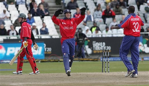 Zimbabwean batsman Brendon Taylor, left, leaves the field after he was caught behind by England's wicket keeper Matt Prior, centre, and bowled by Dimitri Mascarenha, right, during ICC World Twenty 20 cricket Championships at Newlands in Cape Town, South Africa, Thursday, Sept. 13, 2007.