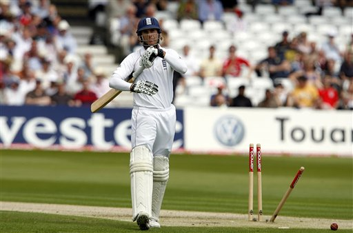Michael Vaughan walks back towards the pavilion after being bowled by New Zealand's Iain O'Brien, unseen, during their 3rd Test match at Trent Bridge Stadium in Nottingham on Thursday June 5, 2008.