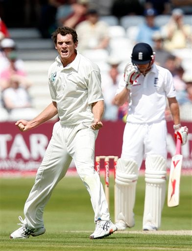 New Zealand's bowler Kyle Mills, left, celebrates the England wicket of Paul Collingwood, right, during their 3rd Test match at Trent Bridge Stadium in Nottingham on Thursday June 5, 2008.