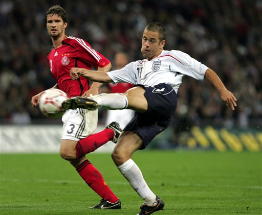 England's Joe Cole shoots at goal during a friendly soccer match between England and Germany at the Wembley Stadium, in London, Wednesday Aug. 22, 2007.