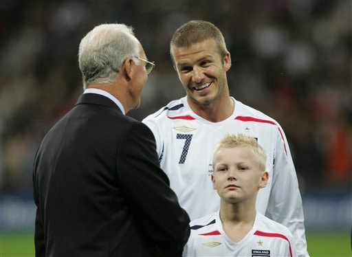German soccer legend Franz Beckenbauer, left, talks with England's David Beckham, prior to the friendly soccer match between England and Germany at the Wembley Stadium, in London, Wednesday Aug. 22, 2007.