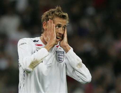 England's Peter Crouch reacts during a friendly soccer match between England and Germany at the Wembley Stadium, in London, Wednesday Aug. 22, 2007.