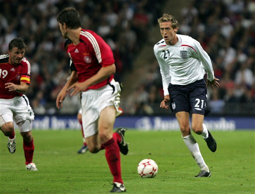 England's Peter Crouch, right, attacks during a friendly soccer match between England and Germany at the Wembley Stadium, in London, Wednesday Aug. 22, 2007.