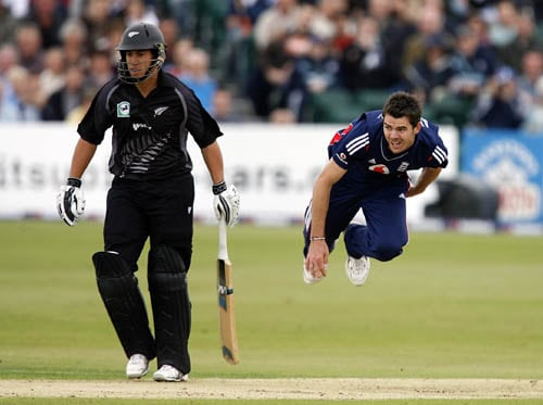 England bowler James Anderson, right, in action as the ball is watched by New Zealand's Ross Taylor during their third NatWest one day international cricket match, at The County Ground in Bristol.