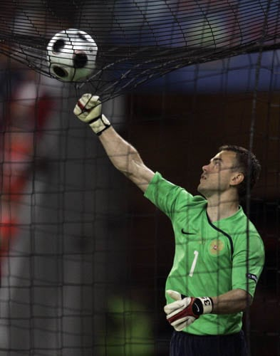 Russia's goalie Igor Akinfeev reaches for the ball over the net during the group D match between Greece and Russia in Salzburg, Austria.