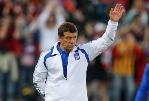 Greece's German coach Otto Rehhagel waves as he leaves the field after losing 0-1 at the group D match between Greece and Russia in Salzburg, Austria.