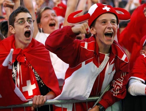 Swiss soccer fans cheer during the live broadcast of the Euro 2008 European Soccer Championships match between Switzerland and Turkey at the public viewing zone in Sion, Switzerland.
