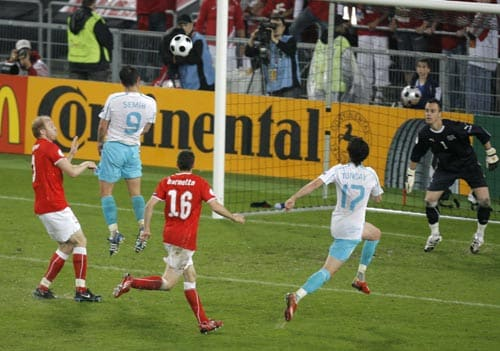Turkey's Semih Senturk, second from left, scores his side's first goal past Switzerland'S goalie Diego Benaglio, right during the group A match between Switzerland and Turkey in Basel, Switzerland.