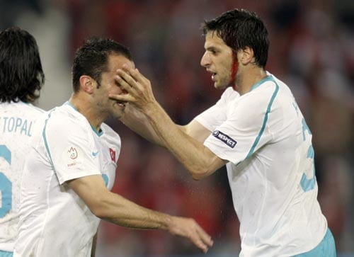 Turkey's Hakan Balta, right, congratulates fellow team member Semih Senturk, left, after he scored the equalizing goal during the group A match between Switzerland and Turkey in Basel, Switzerland.
