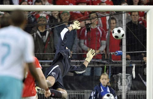 Swiss goalie Diego Benaglio vainly tries to reach for the ball heading into the net as Turkey Semih Sentuerk, not in the picture, scores his side's equalizer.