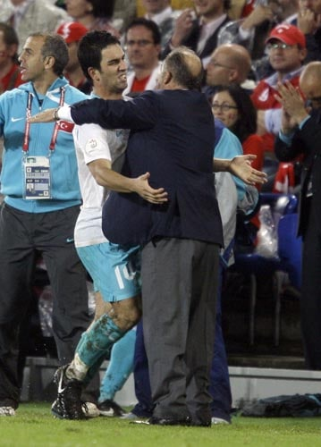 Turkey's Arda Turan, left, and Turkey's head coach Fatih Terim, right, react after he scored the winning goal during the group A match between Switzerland and Turkey in Basel, Switzerland.