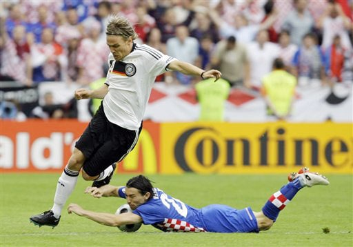 Germany's Clemens Fritz, left, and Croatia's Danijel Pranjic challenge for the ball during the group B match between Croatia and Germany in Klagenfurt, Austria on June 12, 2008, at the Euro 2008 European Soccer Championships in Austria and Switzerland. (AP Photo)