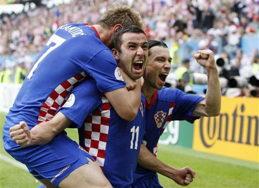 Croatia's Darijo Srna, center, celebrates with his teammates Ivan Rakitic, left, and Danijel Pranjic after scoring the opening goal during the group B match between Croatia and Germany in Klagenfurt, Austria on June 12, 2008, at the Euro 2008 European Soccer Championships in Austria and Switzerland. (AP Photo)