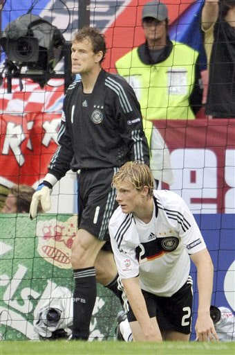 Germany's goalie Jens Lehmann, background, and defender Marcell Jansen react after Croatia's Darijo Srna, unseen, opened the scoring during the group B match between Croatia and Germany in Klagenfurt, Austria on June 12, 2008, at the Euro 2008 European Soccer Championships in Austria and Switzerland. (AP Photo)