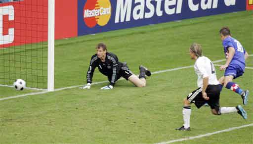Croatia's Ivica Olic, right, scores his team's second goal past Germany's Jens Lehmann, left, and defender Clemens Fritz during the group B match between Croatia and Germany in Klagenfurt, Austria on June 12, 2008, at the Euro 2008 European Soccer Championships in Austria and Switzerland. (AP Photo)
