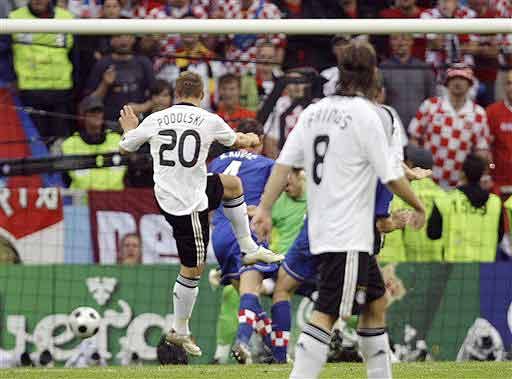 Germany's Lukas Podolski, left, scores during the group B match between Croatia and Germany in Klagenfurt, Austria on June 12, 2008, at the Euro 2008 European Soccer Championships in Austria and Switzerland. (AP Photo)