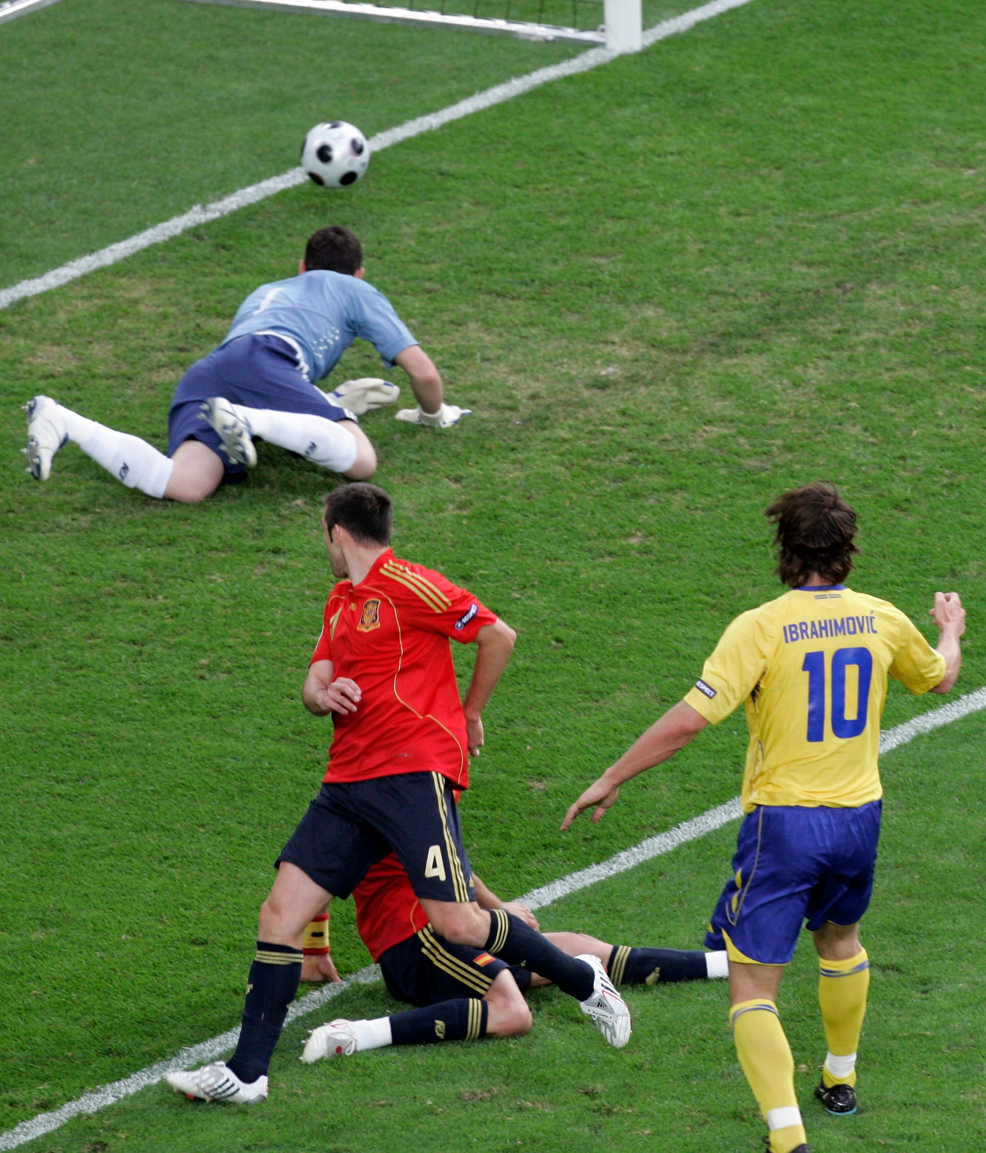 Sweden's Zlatan Ibrahimovic, right, scores during the group D match between Sweden and Spain in Innsbruck, Austria.