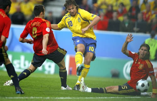 Sweden's Zlatan Ibrahimovic, center, scores during the group D match between Sweden and Spain in Innsbruck, Austria.