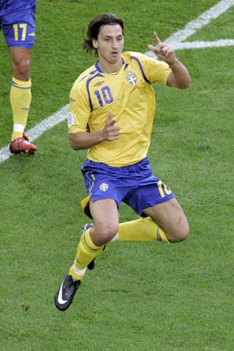 Sweden's Zlatan Ibrahimovic jumps in celebration after scoring his team's first goal during the group D match between Sweden and Spain in Innsbruck, Austria.