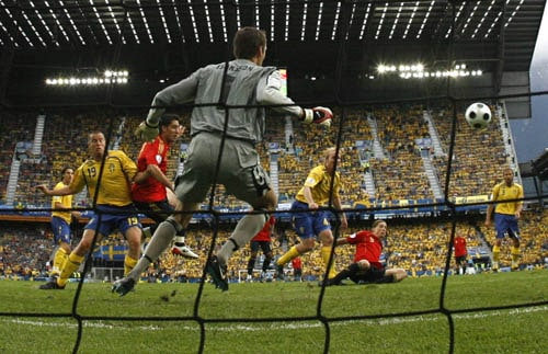 Spain's Fernando Torres, 3nd right, scores the opening goal during the group D match between Sweden and Spain in Innsbruck, Austria.