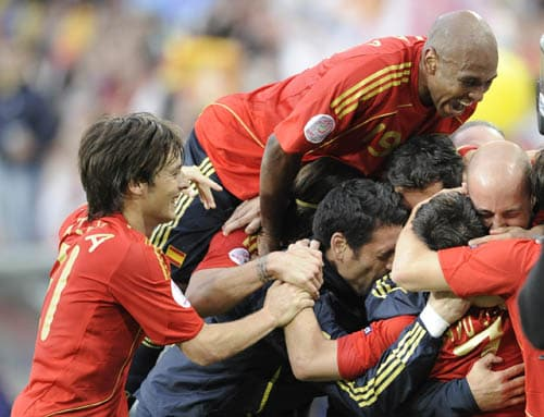 Spanish players celebrate their 2-1 win at the end of the group D match between Sweden and Spain in Innsbruck, Austria.