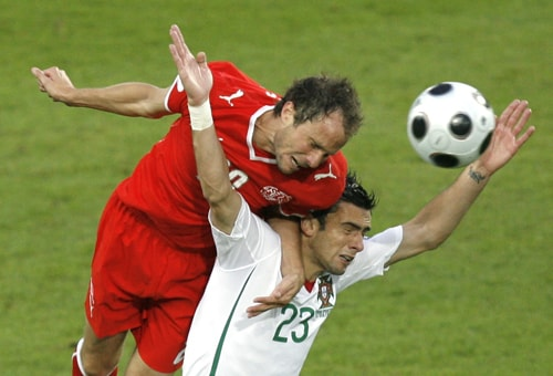 Switzerland's Patrick Mueller, left, and Portugal's Helder Postiga, right, vie for the ball during the group A match between Switzerland and Portugal in Basel, Switzerland.