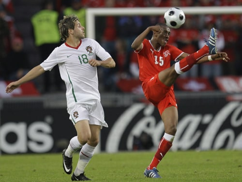 Switzerland's Gelson Fernandes, right, controls the ball as Portugal's Miguel Veloso, left, looks on during the group A match between Switzerland and Portugal in Basel, Switzerland.