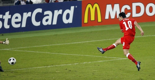 Switzerland's Hakan Yakin scores during the group A match between Switzerland and Portugal in Basel, Switzerland.