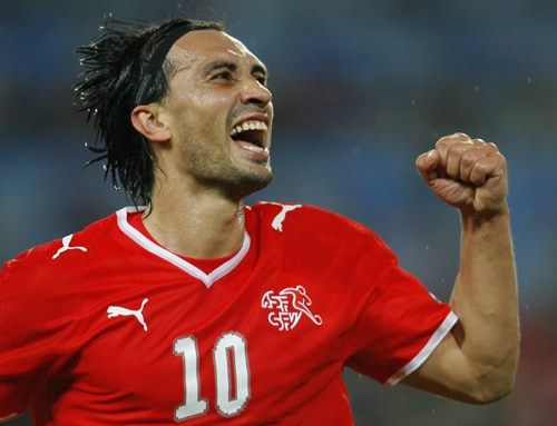 Switzerland's Hakan Yakin reacts after scoring during the group A match between Switzerland and Portugal in Basel, Switzerland.