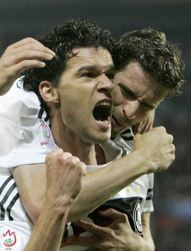 Germany's Michael Ballack, left, is congratulated by his teammate Arne Friedrich after scoring the opening goal during the group B match between Austria and Germany in Vienna, Austria.